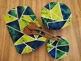 Odd Pod dish and bowl covers, that replaces single use cling wrap options while adding that extra style to your table setting. The dish covers featured are in lovely vibrant green and blue prim shapes.