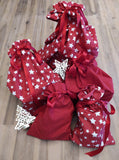Odd Pod 100% cotton gift bags in lovely red and red with white stars, sealed with a red ribbon. Various sizes available in the sets offered.