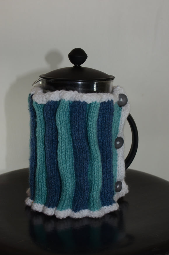 Hand knit coffee plunger warmer in denim blue, duck egg and white colours