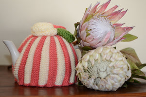 By the Tea Cosy Project - Hand knit protea range with a ray of pinks, beige and greens. Finished off with flowers on top.
