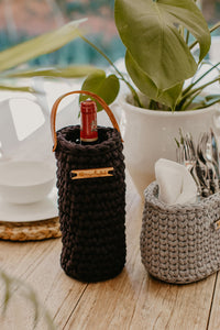 Wine Holder handmade from recycled spaghetti yarn, featured with a leather handle. Available in various colours.