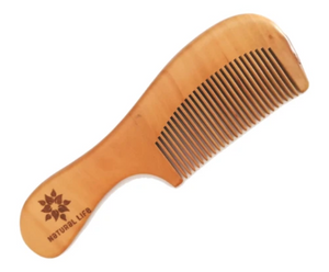 A natural comb that is made from sustainably sourced FSC approved Pear wood