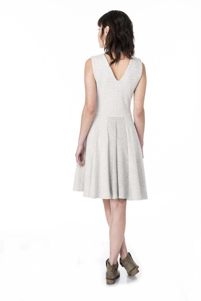 pleated a-line fit and flare dress with full circle skirt, pockets, and color blocking detail V-neck back view