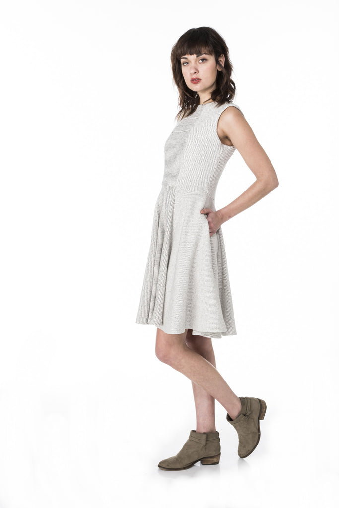 pleated a-line fit and flare dress with full circle skirt, pockets, and color blocking detail side view