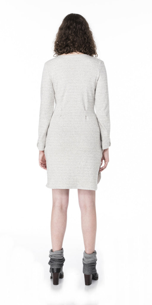 fitted sweater knit dress with waist pleats scalloped cuffs and curved hem line back view
