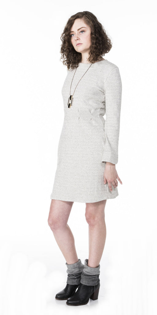 fitted sweater knit dress with waist pleats scalloped cuffs and curved hem line