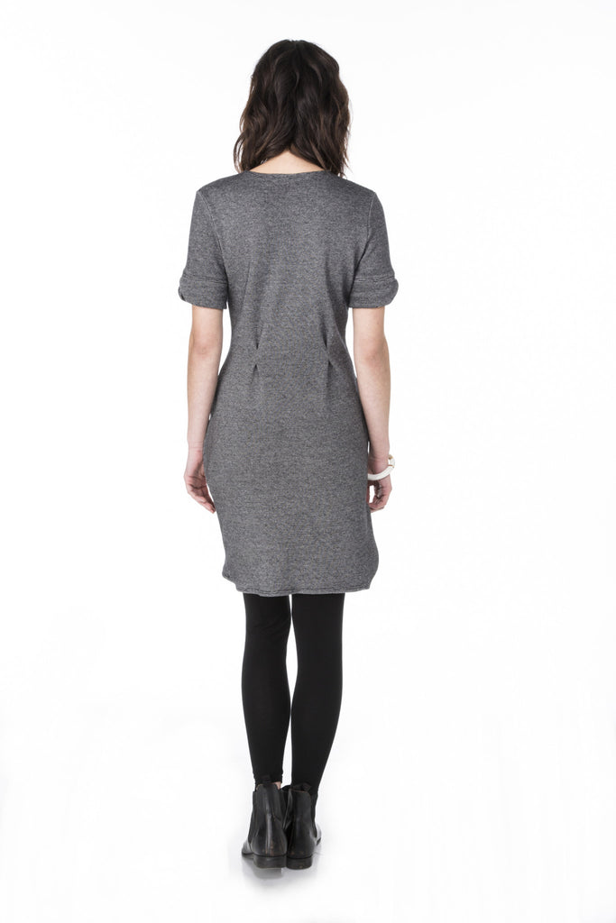 fitted sweater knit dress with short sleeves waist pleats scalloped cuffs and curved hem line back view