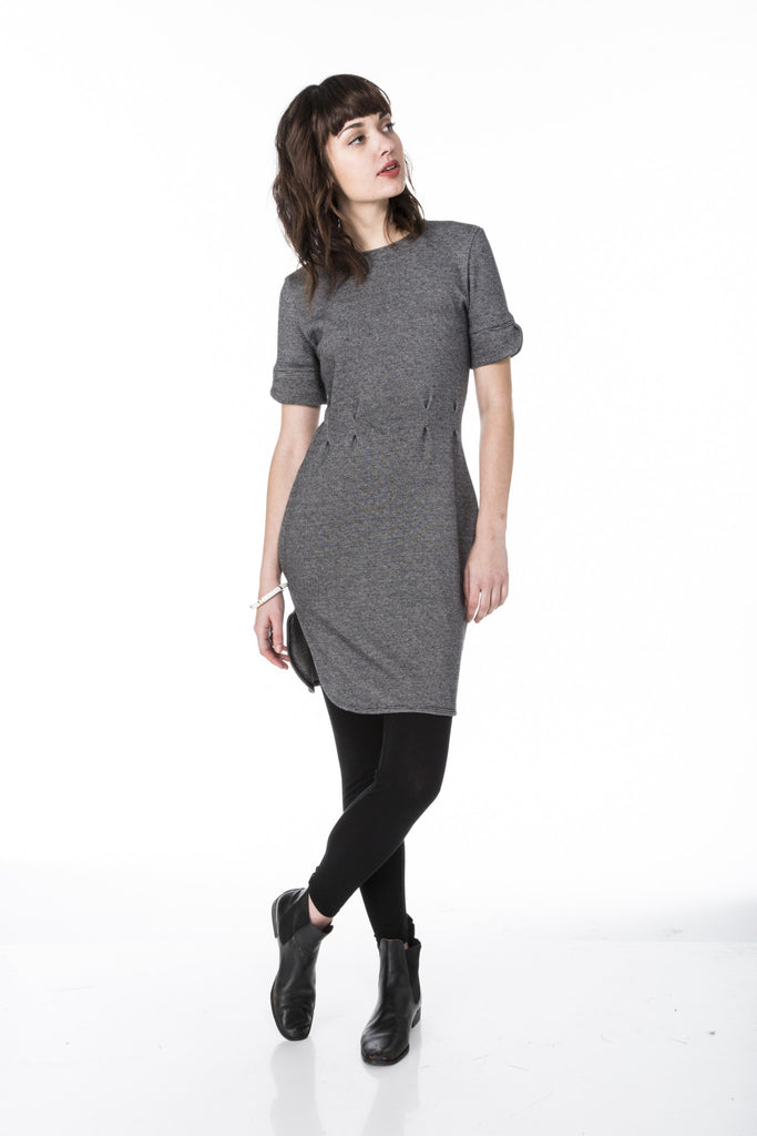 fitted sweater knit dress with short sleeves waist pleats scalloped cuffs and curved hem line front view