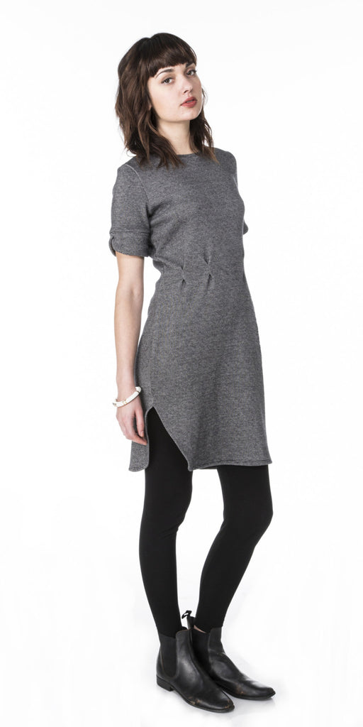 fitted sweater knit dress with short sleeves waist pleats scalloped cuffs and curved hem line