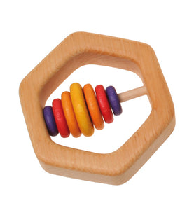 A wooden hexagon teathing ring with seven coloured wooden discs in purple, red and yellow on a white background.