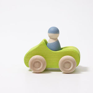 Small Green wooden Convertible Car with a blue wooden peg doll inside on a white background.