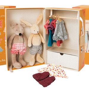 on a white background, A picture of an open suitcase-style box with two plush animals wearing undershorts on one side, and on the other side a hanging bar with clothing and a drawer that can be opened. Two peices of clothing are at the forefront.