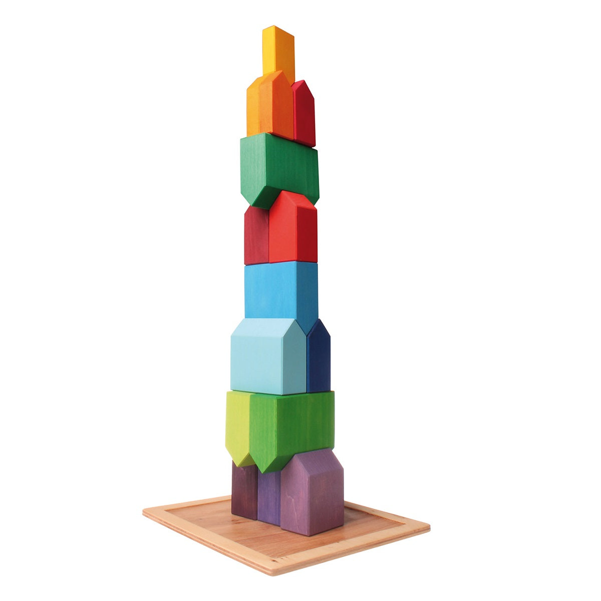 on a white background, a natural wooden square tray, with multi coloured houses stacked on top of each other into a tall tower.