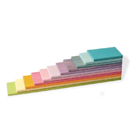 on a white background, a set of wooden planks in pastel colours stacked on top of each other from largest to smallest