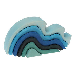 wooden waves in various shades of blue nested into each other on a white background