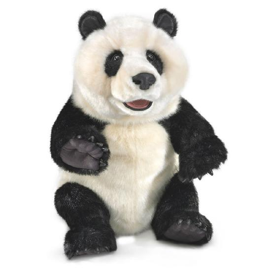 On a white background, a giant black and white realistic plush panda