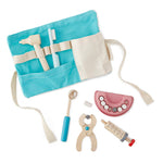 on a white background, a blue and natural canvas belt bag with dentist tools in it. also dentist tools next to the bag.