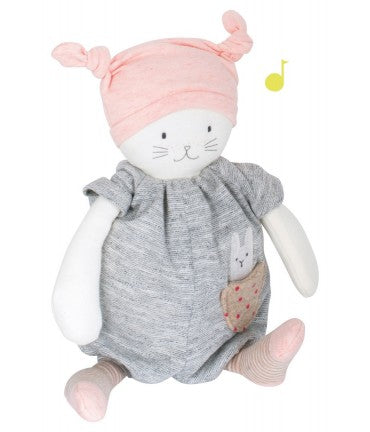 On a white background, a white plush cat in grey jersey pyjamas and a pink hat with a knot on each side.