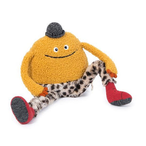 On a white background, a plush round charater with a small black sparkly bowler hat and leopard print soft pants, red boots, two eyes and a wide embroidered smile.