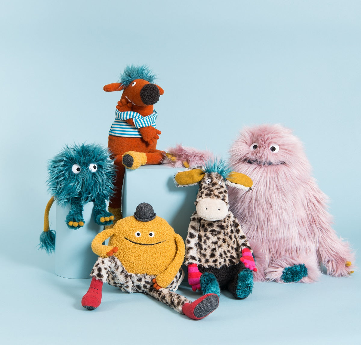 In a blue room, a bunch of colourful plush characters