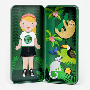 The open box with the same girl, now wearing a white shirt and a black skirt and shoes. On the other side of the box there is a jungle scene with a sloth, a tucan and a lemur and some butterflies. On a white background.