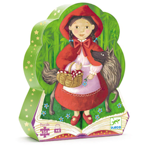 The box is shown on a white background, an illustrated picture of little red riding hood and the wolf wrapped around her. They are stading on an open story book. The box is shaped like the figures.