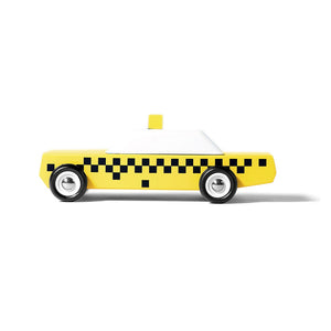 on a white background, a retro yellow checkered cab with white top and black wheels