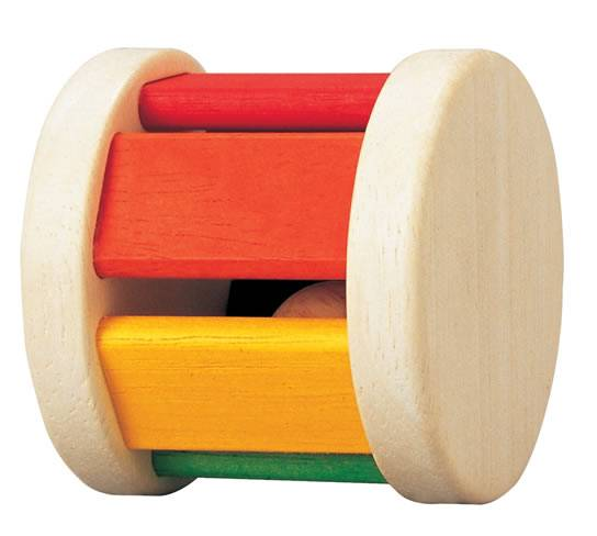 On a white background, a wooden wheel shaped rattle with colourful sections