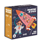 a dark blue and yellow box on a white background. Illustrastions of a girl astronaut and a pink rocket are on the front