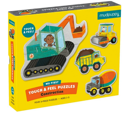 A yellow puzzle box with some construction vehicles all over it on a white background.