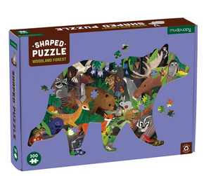 A purple puzzle box with a bear shape filled in with a forest scene on a white background.
