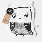 on a white background, a black and white graphic drawing of an owl on a thin white fabric with two cotton twill tabs at the top.