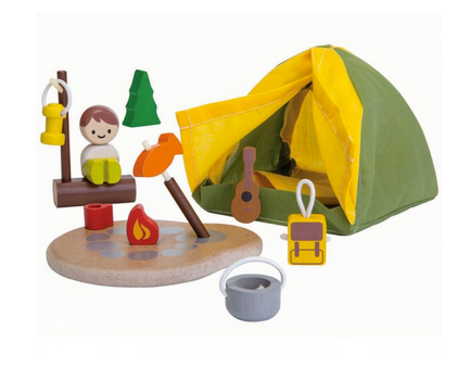 Colourful wooden camping items on a white background.