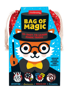 A red bag covered with a blue piece of cardboard with a fox in a magician's outfit on a white background.