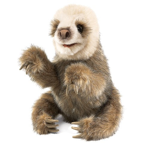 a plush baby sloth on a white background