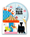 A die-cut board book on a white background with a carousel , train, rollercoaster and ferris wheel peeking out at different levels of the die cut.