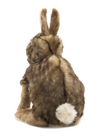 Rear view of a plush cottontail rabbit sitting on a white background