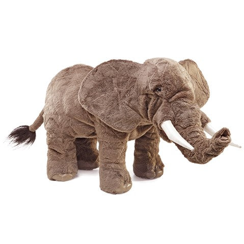 a large plush realistic elephant on a white background