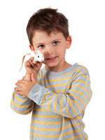 a small white plush mouse with a long tail being held by a young boy