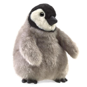 a plush grey, black and white penguin chick on a white background
