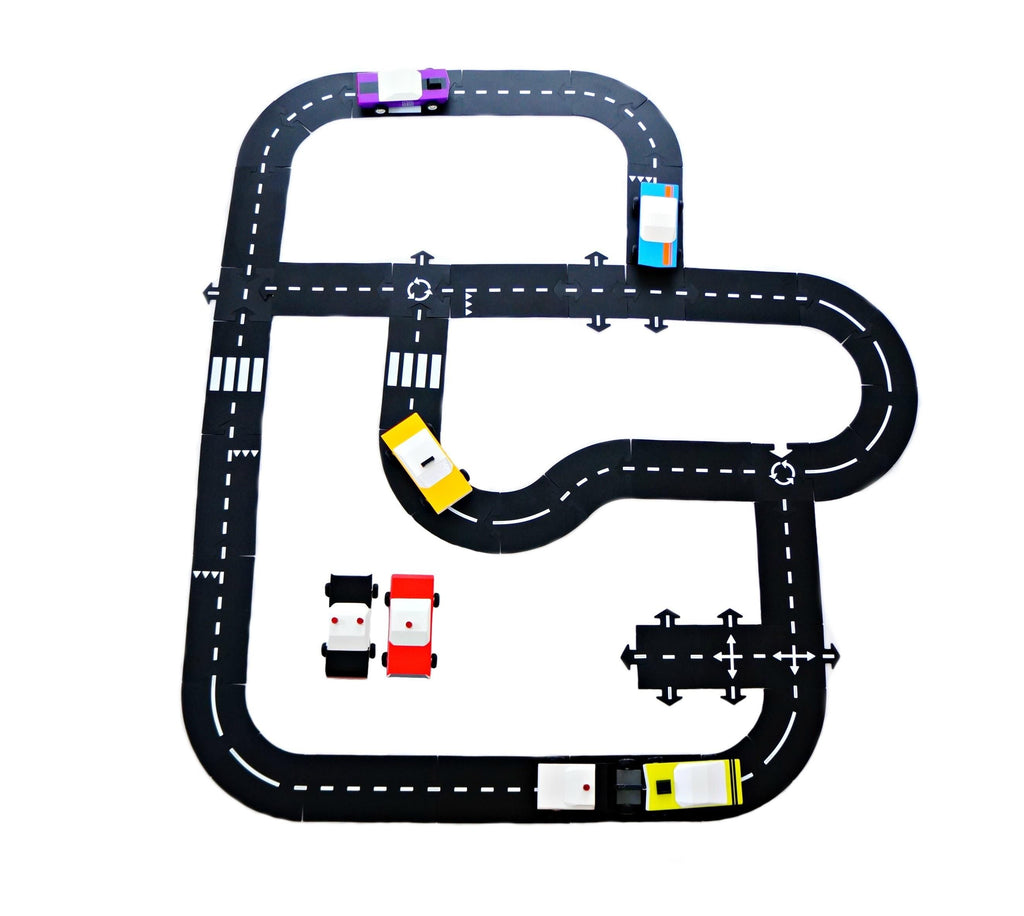 on a white background, a black roadway with dotted lines and straight, curved and looped sections.