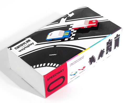 box on a white background with road pieces and a blue race car and a red race car on it.