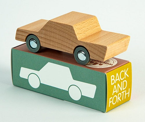 on a white background, a natural wooden car on a box