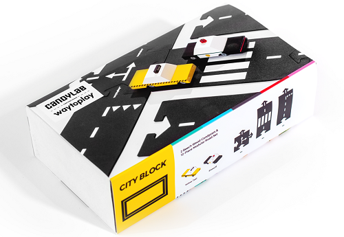 A box on a white background that has road way, a taxi and a police car on it. Collaboration between candylab and waytoplay