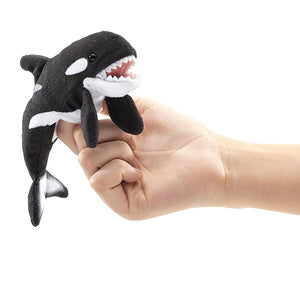 on a white background, a plush orca held by someone's fingers