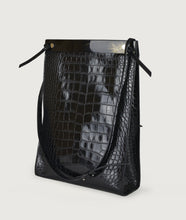 Load image into Gallery viewer, Gwyneth bag, size L, black with croco effect embossed. Gwyneth bag in size L, black with croco effect embossed. It is made from Italian calf leather. The front plate is made from cow horn. Adjustable shoulder strap. Perfectly suitable for A4 formats and all iPad sizes.