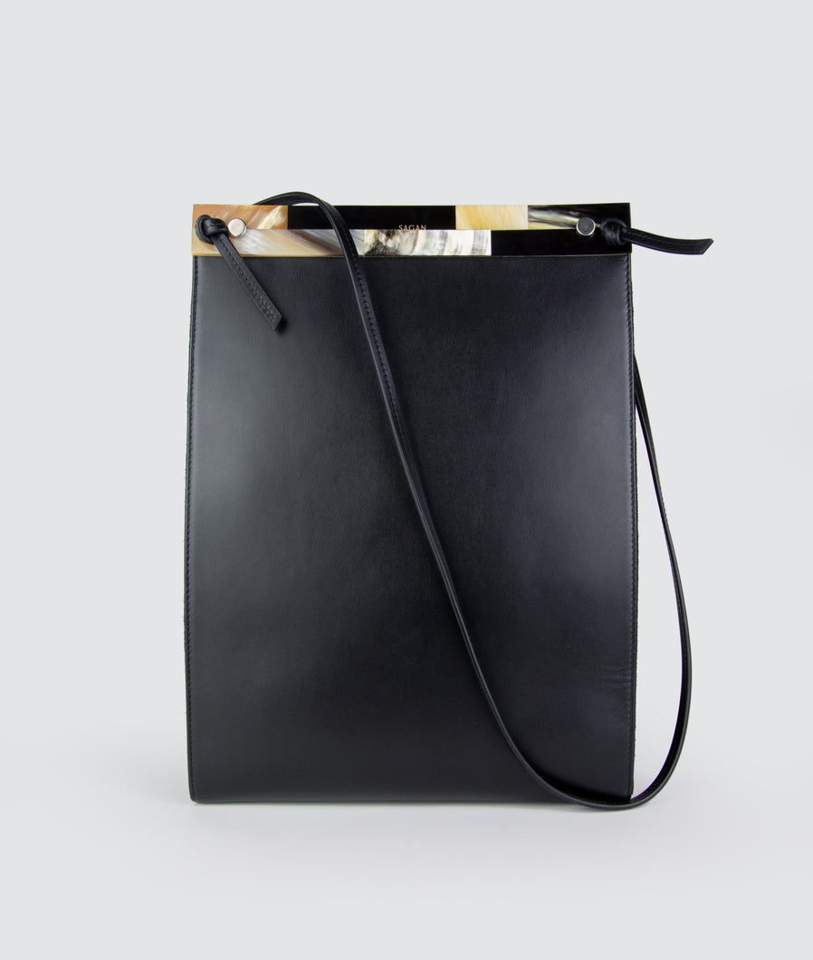 SAGAN Vienna - Gwyneth bag black, size L, made from Italian calf leather, with mosaic front plate from cow horn. Adjustable shoulder strap, perfectly suitable for all Ipad sizes.