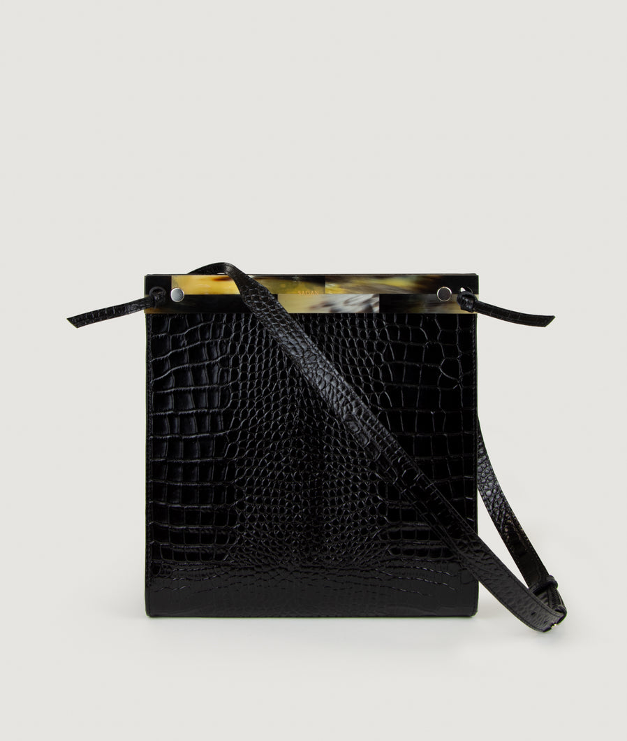 Gwyneth handbag, black, Size M, made from croco embossed Italian smooth calf leather. The mosaic front plate is made from cow horn. Shoulder strap is adjustable and in the function of easy closing and opening the bag. Unique and Elegant.