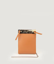 Load image into Gallery viewer, Gwyneth bag, crossbody bag, size S, in camel, made from Italian calf leather. This size is suitable for all iPhone sizes. The front plate is made from cow horn. Fine chain shoulder strap. Elegant and contemporary.