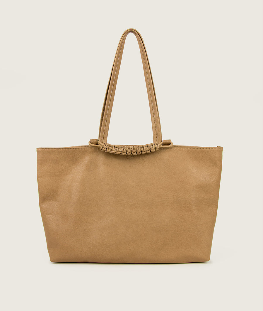 SAGAN Vienna - Tote bag from vegetable tanned spanish goat leather, in beige. The hand braided signature leather handle is functioning as a fastening detail.
